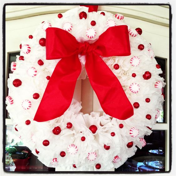 Stunning coffee filter wreath deaorated with peppermint, balls and bow.