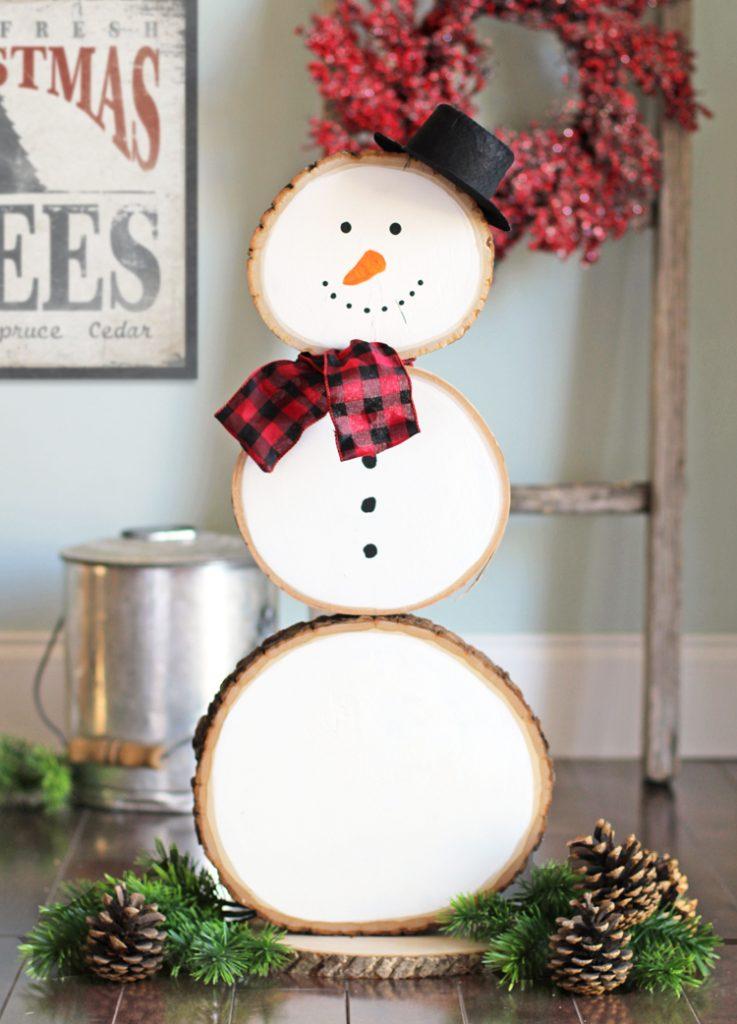 Swanky wood slice snowman.