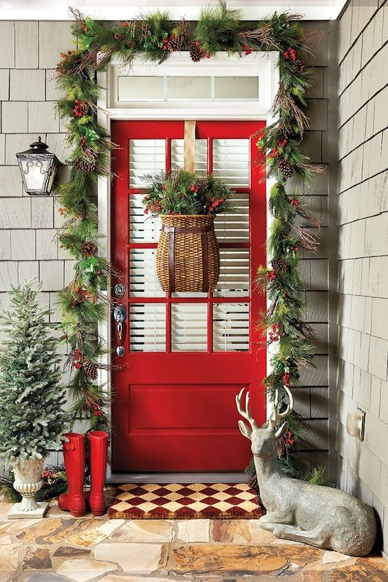 Ultimate front door decoration for Christmas with flower basket, garland, tree and Reindeer.