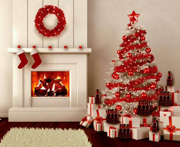 Vibrant red garland, white tree with red balls and gifts.