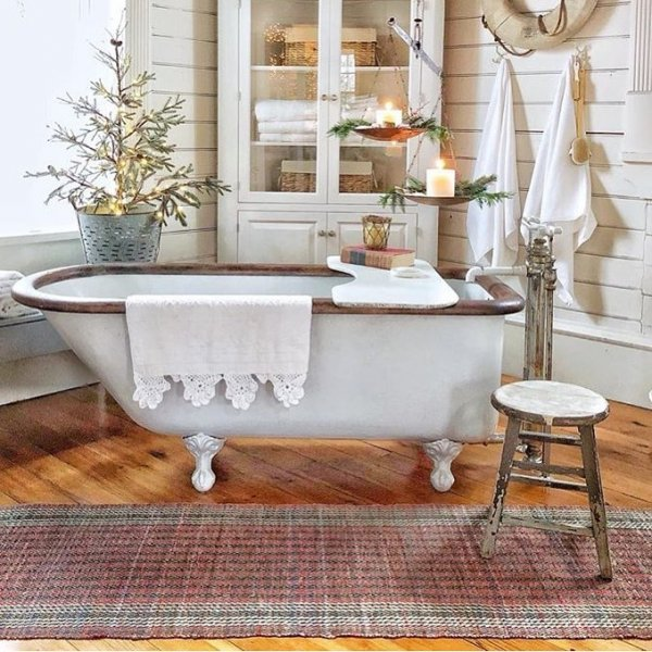 Vintage style Christmas bathroom decor with table top tree and candles.