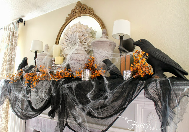 Vintage style halloween mantel decor with crows.