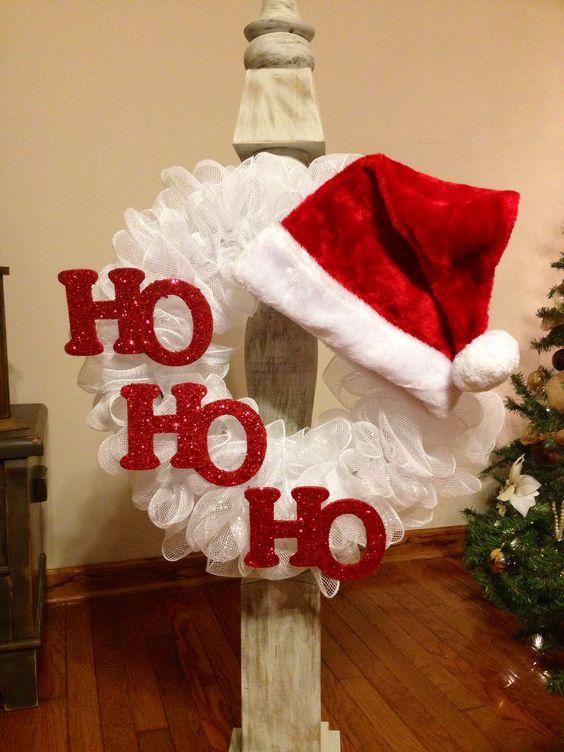 White deco wreath with red Santa cap.