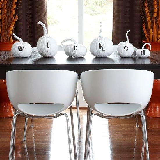 Wicked white pumpkin table decor.