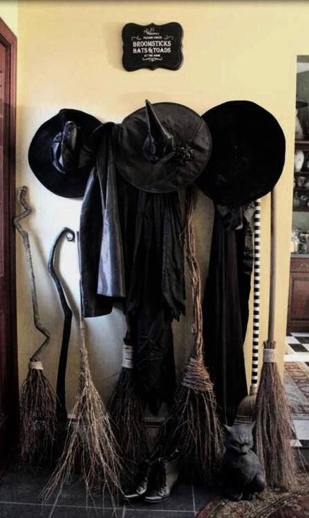 Witch broom and hats used to decor home.