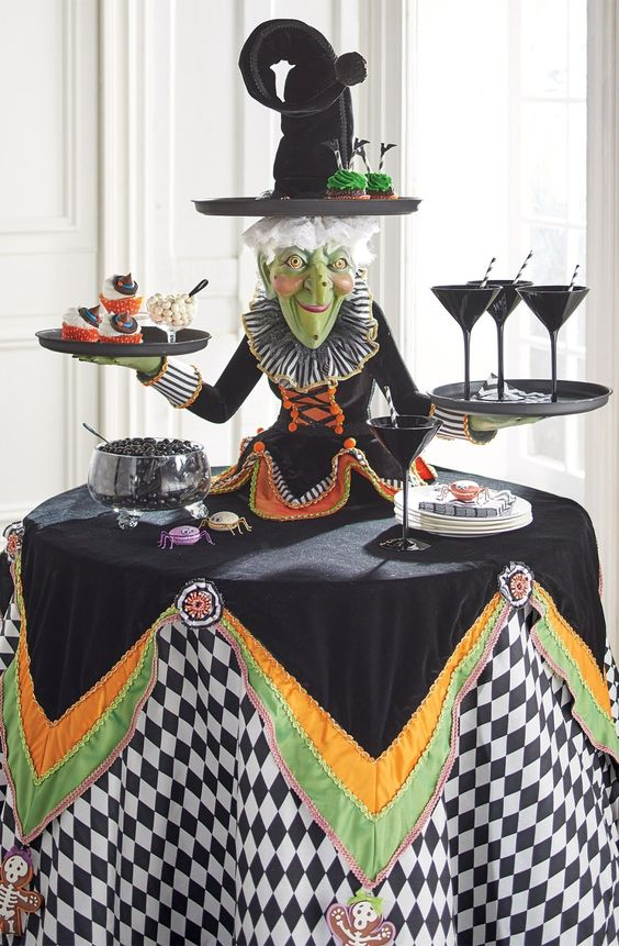 Witch tabletop dessert server at the center perfect for Halloween party.