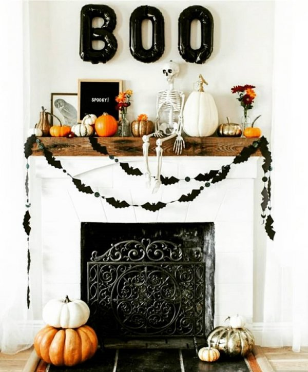 Wonderfully decorated fire place for Halloween party.