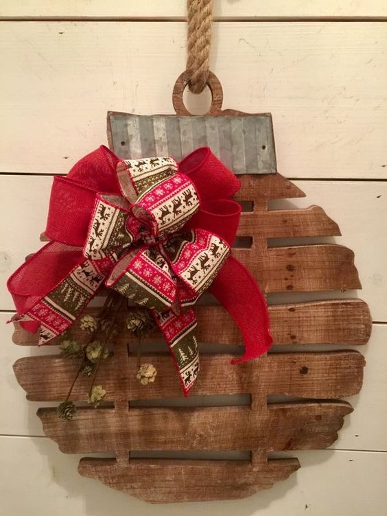 Wooden Wreath Decorated With Reindeer Print Ribbon.