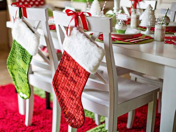 Wow sequined hanging Santa socks on chairs for Christmas dinner.
