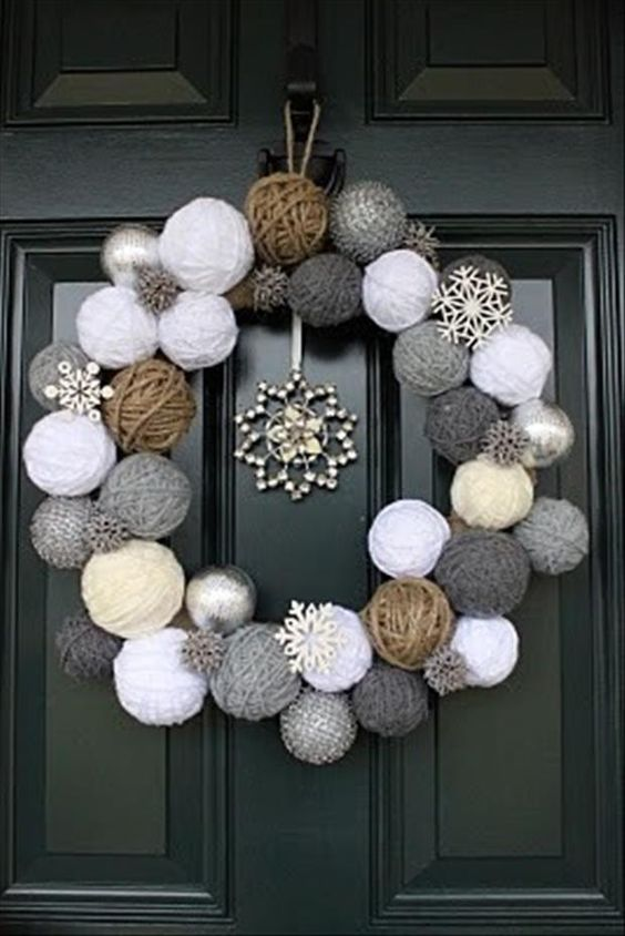 Yarn ball wreath with snowflakes.