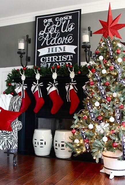 Adorable Christmas mantel decor with beautiful red stockings.