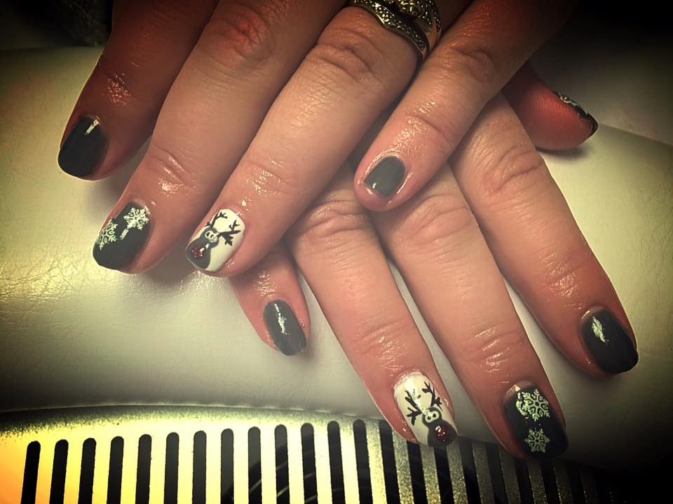 Adorable rudolph, snowflake, white and grey Christmas nails.