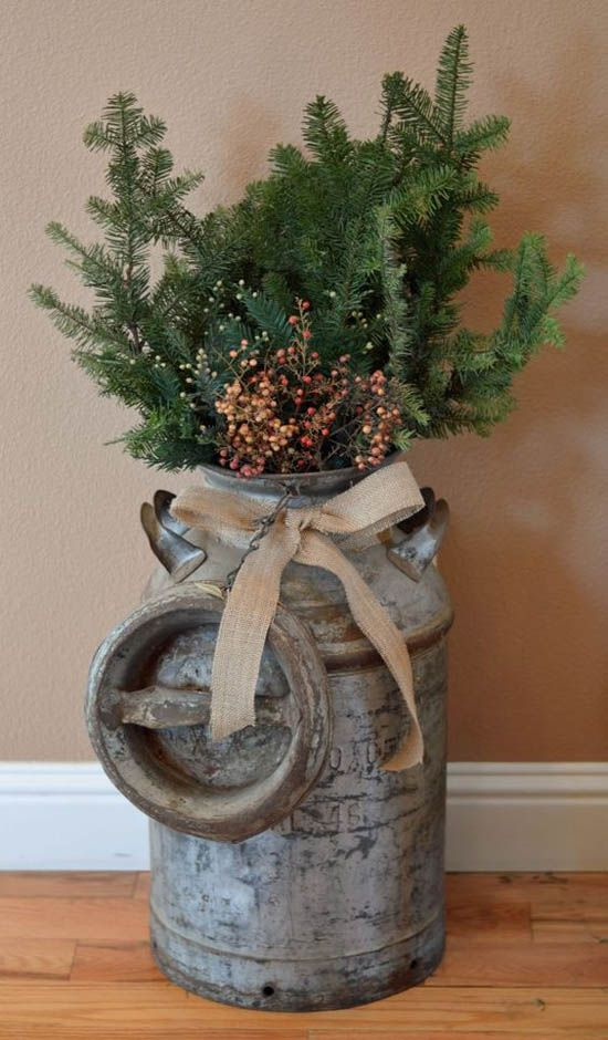 Adorable vintage milk can continue with large evergreen branches accented with berries.