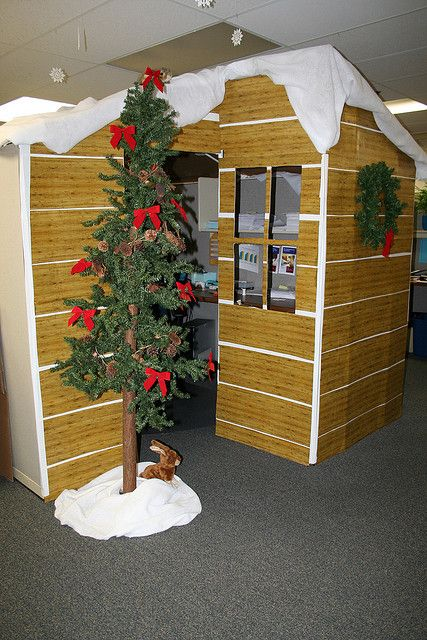 Amazing cubicle decor with Christmas tree.