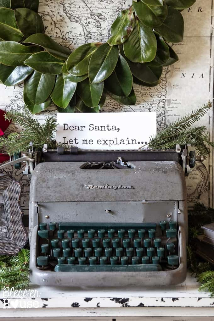 Antique typewriter with fresh leaves wreath.