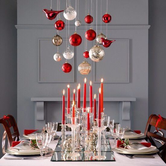 Awesome red decoration with candle and ornaments hanging.