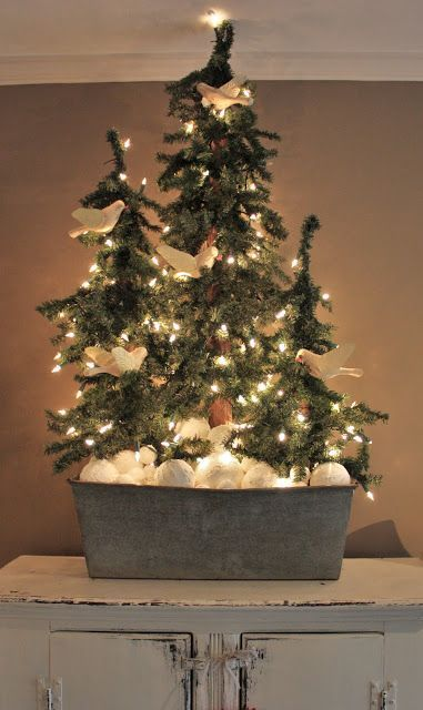 Awesome three Christmas tree with clay ornaments and lights in tin box.