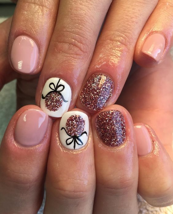 Awesome white and pink glitter nails with Christmas ornament.