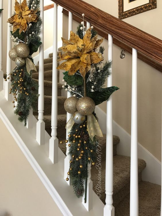 Beautiful handcrafted greenery and floral swags on staircase banister.
