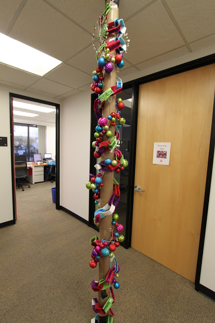 Beautiful ornaments garland wrap around pole.