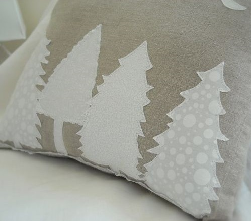 Beige pillow with white Christmas tree.