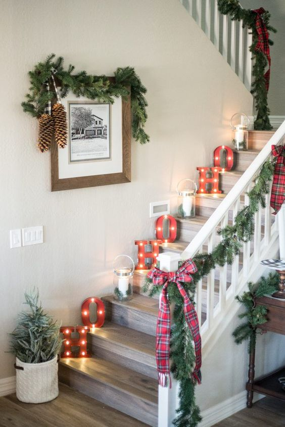 Big letter with lantern on atep with garland and plaided ribbon for Staircase decoration.