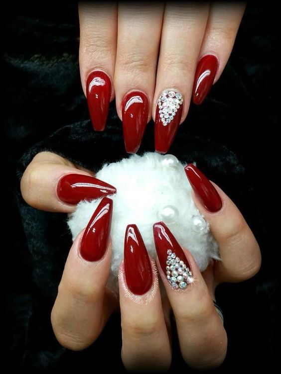 Blood red long nails with swarvoski crystals.