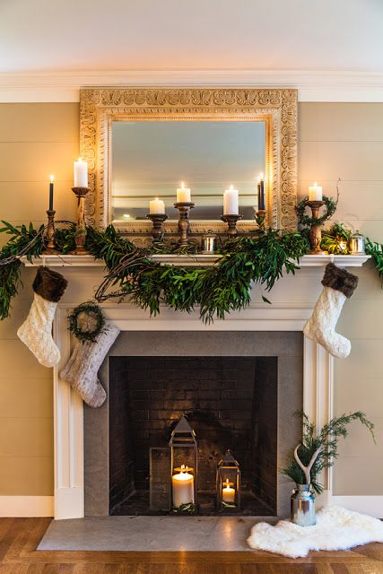 Candles, lantern and stocking for mantel decoration.