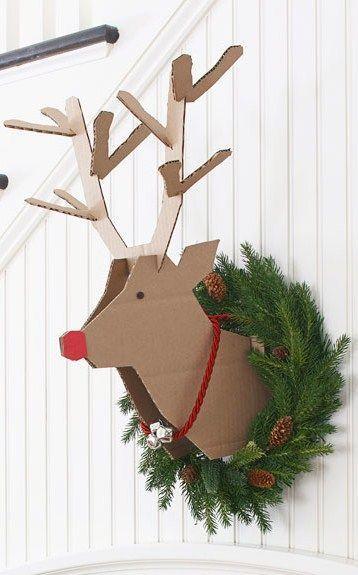 Cardboard reindeer with fresh wreath.