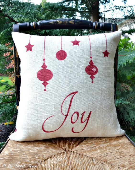 Charming joy pillow cover with ornament.