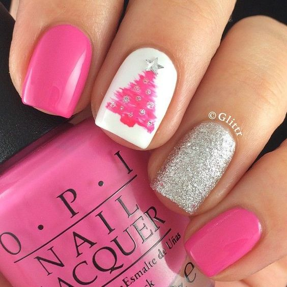 Charming pink Christmas nails with silver.
