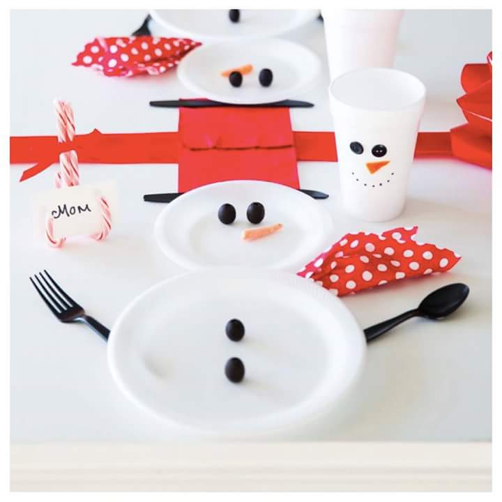 Charming snowman theme Christmas table setting for kids party.