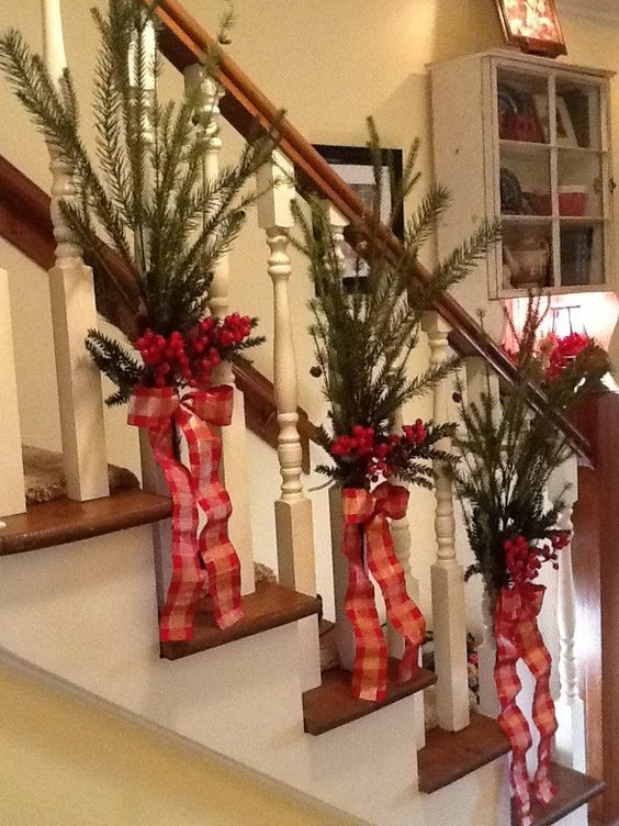 Chic banister decoration with plaid ribbon, leaves and berries.
