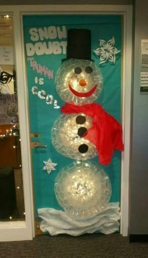 Clear plastic cup snowman with light on classroom door.