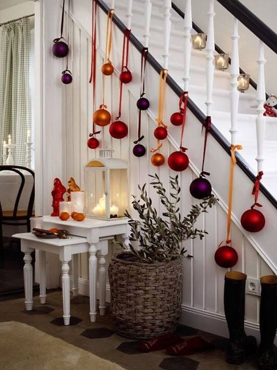 Colorful ornaments hanging with ribbon from banister.