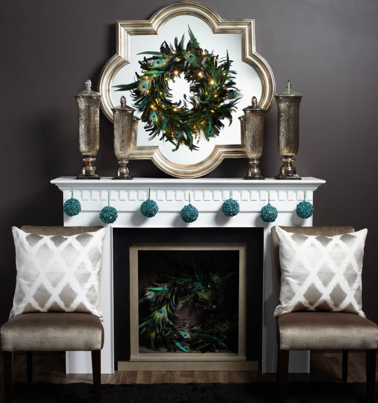 Contemporary mantel decor with peacock wreath and blue ornements.