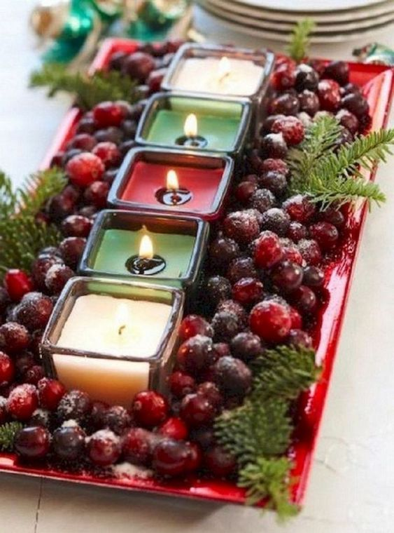Cranberries candles garnish with a few pine twigs and dust with artificial snow.