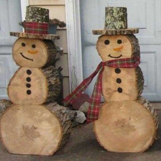 Creative idea of wood log snowman for Christmas outdoor decoration.