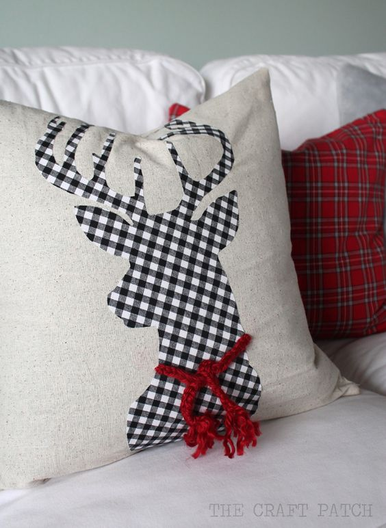 Dashing buffalo check reindeer pillow.
