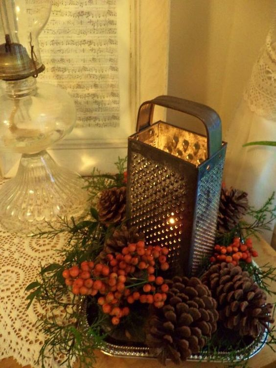 Dazzling vintage decor of pinecone and cherries with cheese cutter.