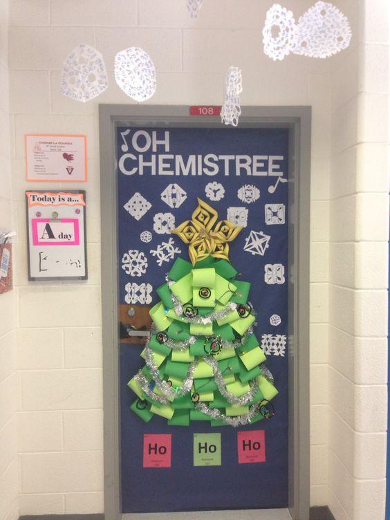 Decorative classroom door with paper Christmas tree.
