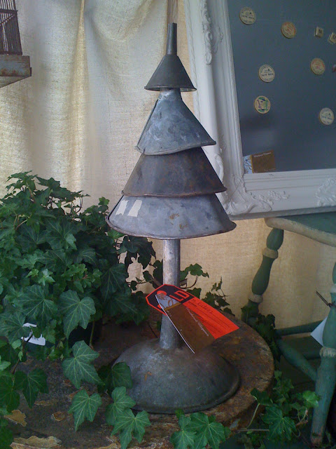Different size funnels arranged as Christmas tree.