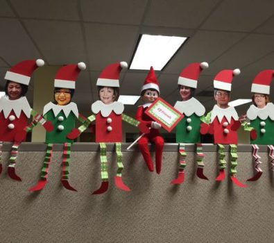 Elf on the shelf at the office.