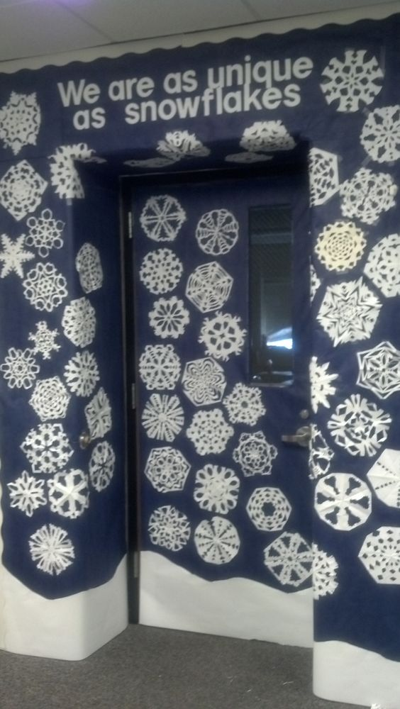 Eye-catching we are unique at snowflakes classroom door decor.