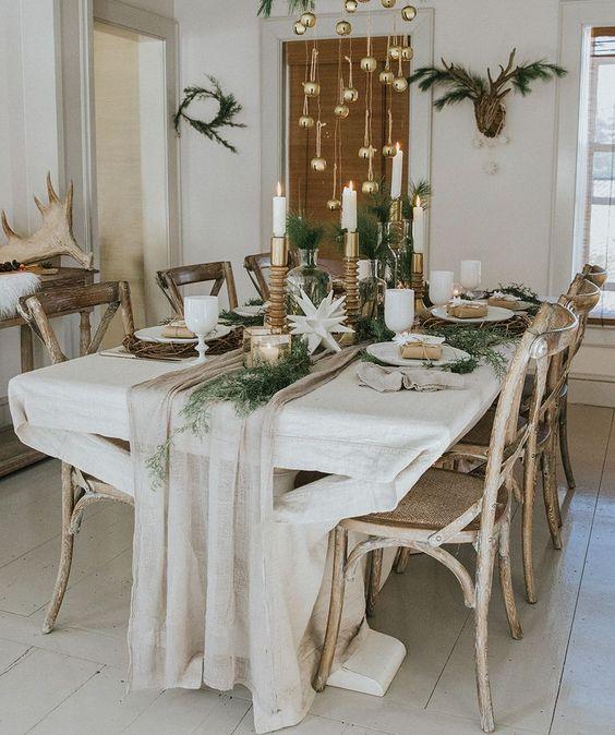 Fabulous fresh Christmas table decor with golden hangings.