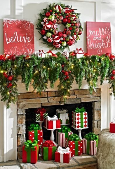 Freash garland, ornaments wreath and wooden sign board for mantel.