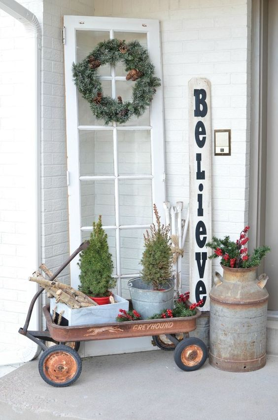Front porch is decorated in vintage style.