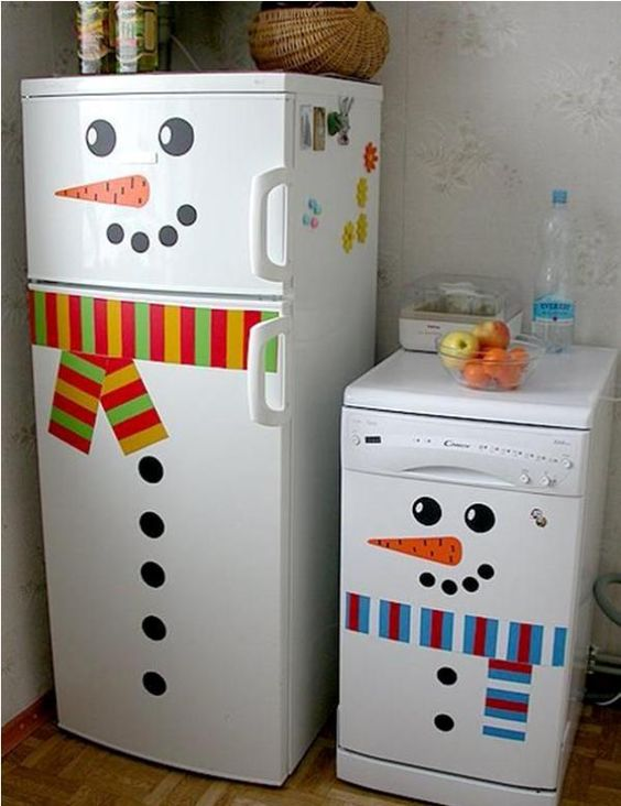 Funny way to decorate fridge and dishwasher as snowman.