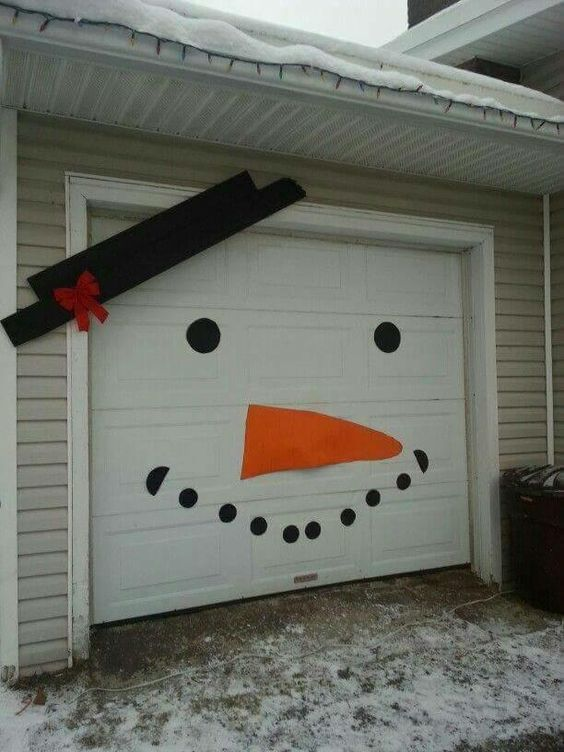 Garage is decorated as snowman.