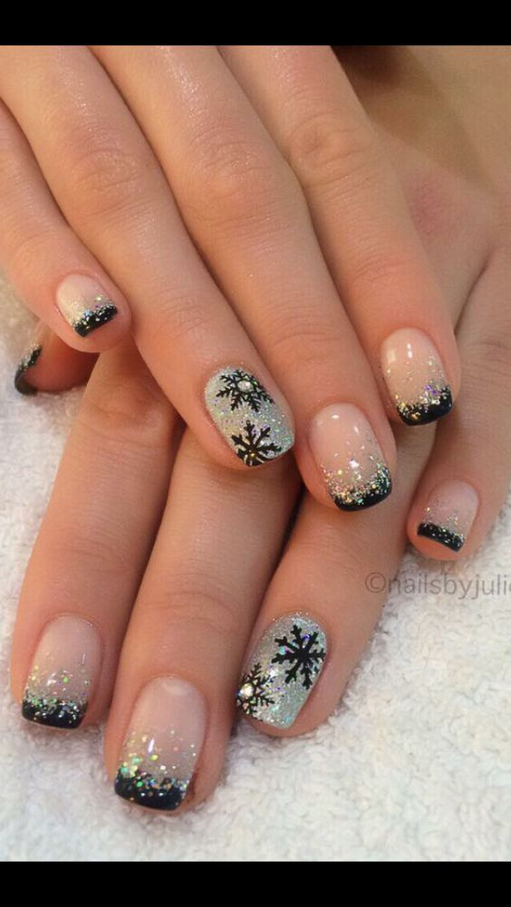 Great silver glitter nails with black snowflakes for Christmas.